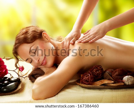 Spa. Beautiful Woman in Spa Salon getting Massage. Healthy massage of body in spa salon. Beauty treatment concept. Masseur doing massage. Relaxing - stock photo