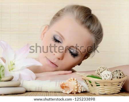 Spa beautiful Woman on a bamboo background - stock photo