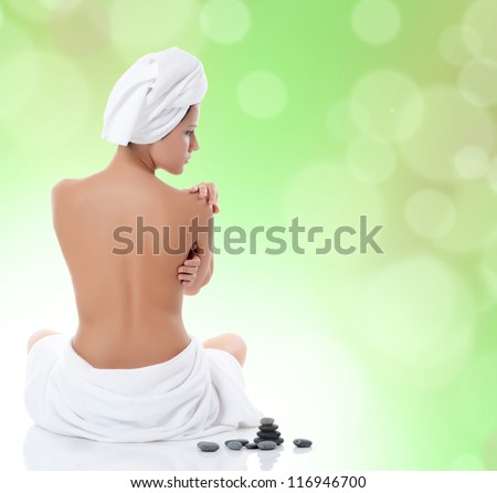 Spa beautiful woman on a green background - stock photo