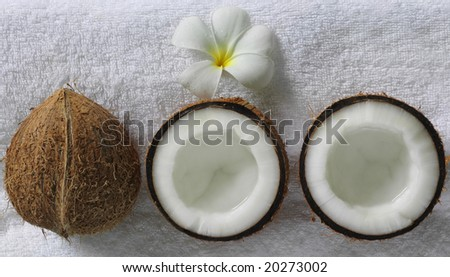 spa beauty exotic tropical flowers coconuts on white towels