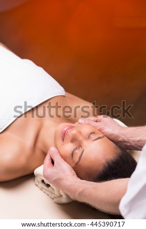 Spa beauty lying on her back during relaxing massage