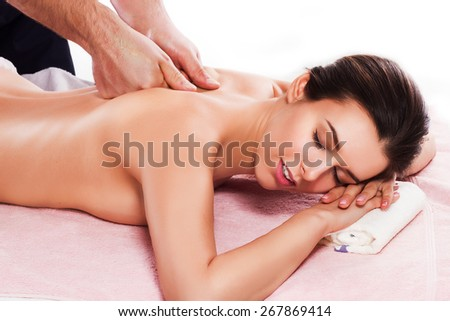 Spa beauty skin treatment woman on white towel. Caucasian female model with perfect skin lying on towel. Young woman isolated on white background.