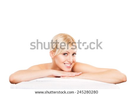 Spa beauty skin treatment woman on white towel. Gorgeous beautiful female model with perfect skin lying on towel. Young woman isolated on white background. - stock photo