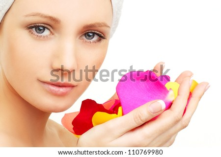 Spa beauty - woman with rose petals - stock photo