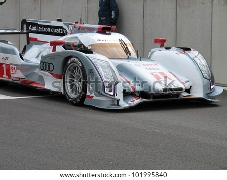 SPA, BELGIUM - MAY 4: Swiss racing driver Marcel F�¤ssler leaving the pitlane in the new Audi R18 e-tron quattro hybrid prototype car at circuit Spa-Francorchamps May 4, 2012 in Spa, Belgium. - stock photo