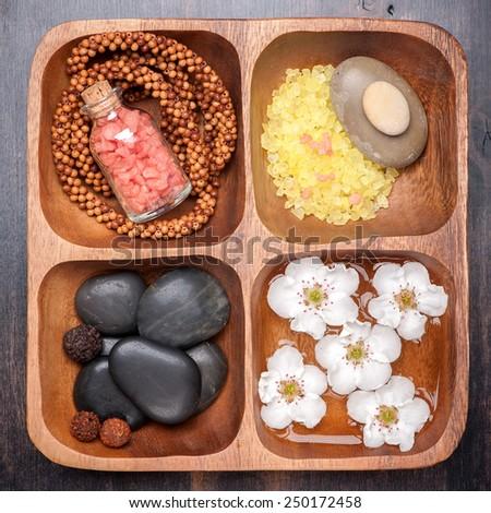 Spa , body care, manicure. Sea salt, Zen massage stones, essential oils and flowers  - stock photo