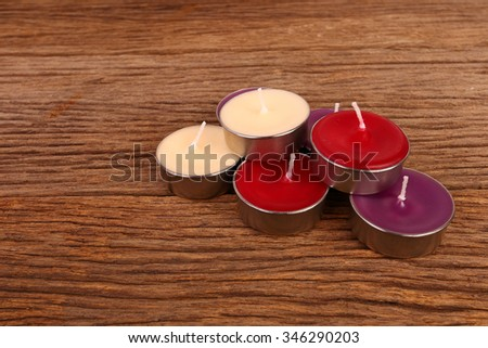 spa candles on a wooden background