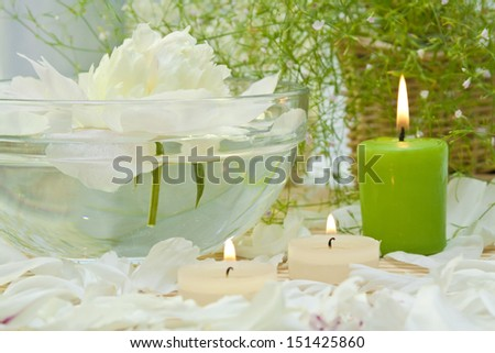 spa candles with peony petals - stock photo