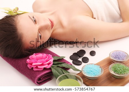Spa. Care Facial. Beautiful Young Woman Getting a Face Treatment at Beauty Salon.