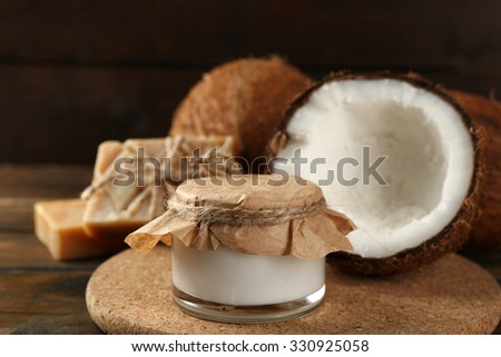 Spa coconut products on dark wooden background - stock photo
