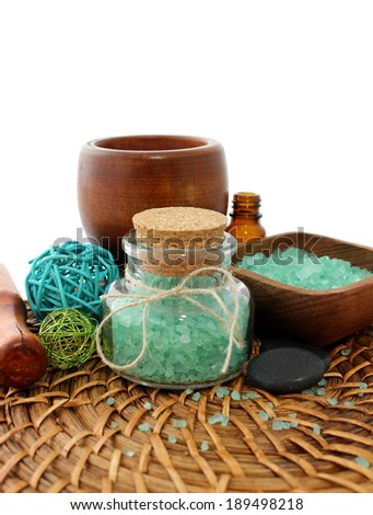 spa composition of bath salt, bottle and stone - stock photo