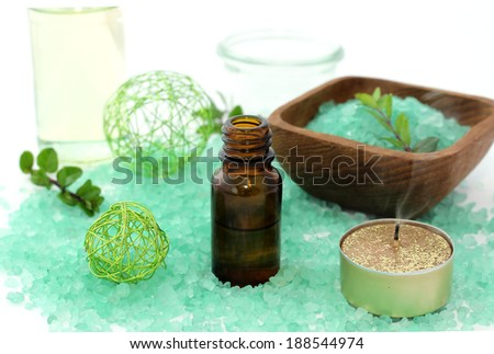 spa composition of bath salt, candle and bottle  - stock photo