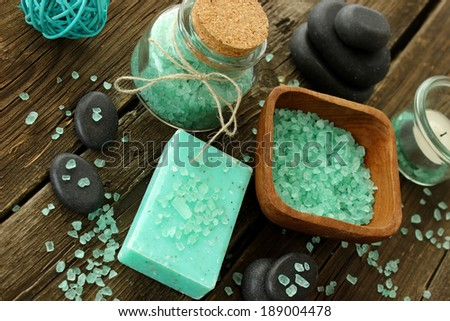 spa composition of soap, bath salt and stones on old wooden boards - stock photo