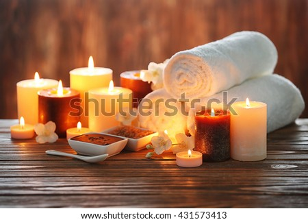 Spa composition with candles on blurred background