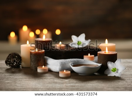 Spa composition with candles on brown background - stock photo