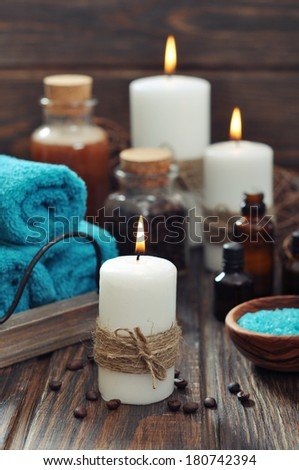 Spa composition with towels, candles and sea salt on wooden background