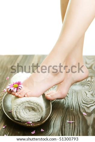 Spa concept.Beautiful Woman Legs with flower - stock photo