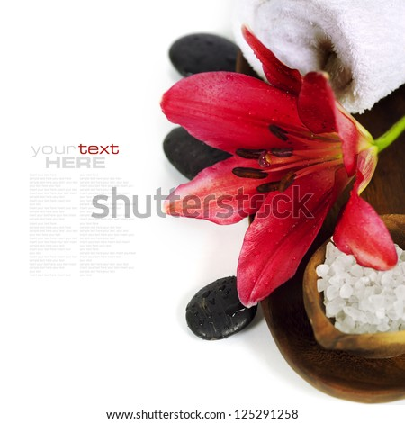 Spa concept (flowers, towel, sea salt and massage stones) (with easy removable sample text) - stock photo