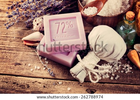 SPA concept, lavender soap on an old wooden table - stock photo