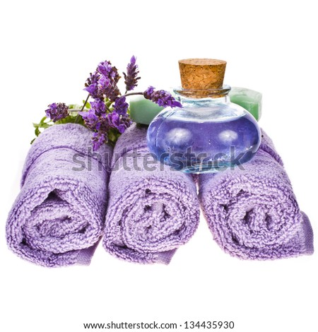 spa concept - towels,  avender water, lavender flowers isolated on white background isolated on white background - stock photo