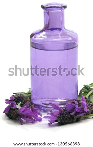 Spa concept with aromatic lavender and massage oil - stock photo