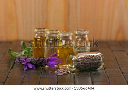 Spa concept with aromatic lavender and massage oils - stock photo