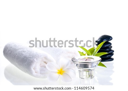 Spa concept with black zen stones and white flower over white background - stock photo
