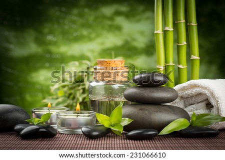 spa concept with zen basalt stones and massage oil - stock photo