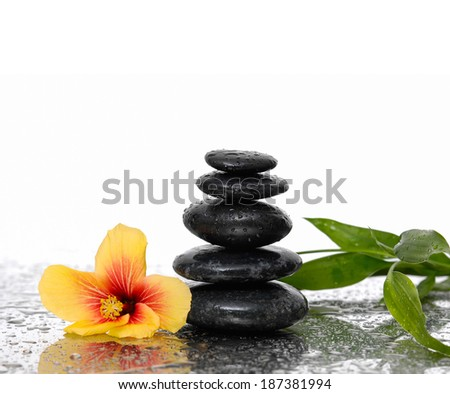 spa concept with zen stones and lily bamboo - stock photo