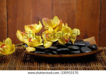 spa concept zen basalt stones and orchid,mat - stock photo