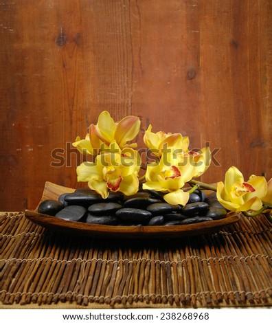 spa concept zen basalt stones and orchid, mat - stock photo