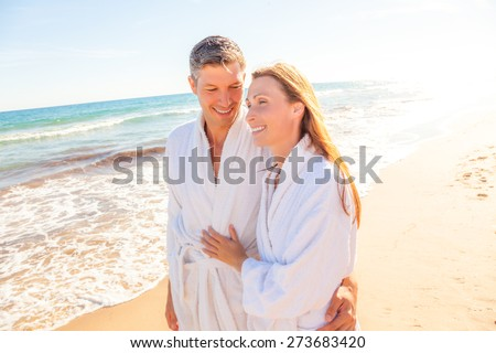 spa couple relaxing while walking beach