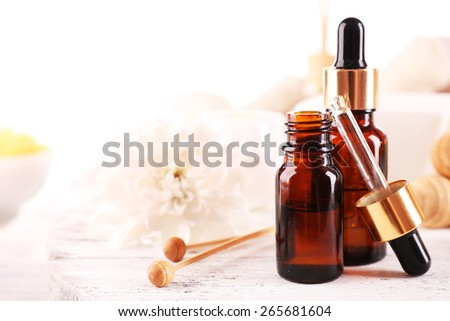 Spa dropper bottles with essence on wooden table, closeup - stock photo