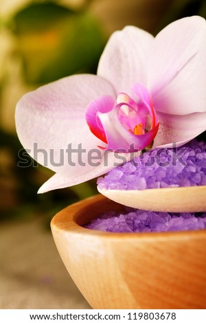 Spa elements - salt with flower of orchid - stock photo