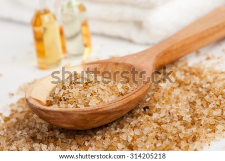 Spa essentials (bath salt in a spoon and bottles) - stock photo