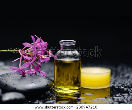 Spa feeling with candle , pebbles, branch orchid - stock photo