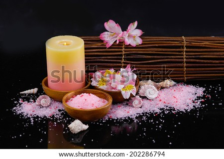 Spa feeling with pink orchid, candle, mat ,salt in bowl