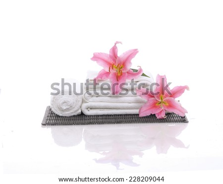 Spa feeling with two lily ,towel , mat - stock photo