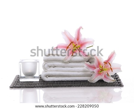 Spa feeling with two lily ,towel on mat - stock photo