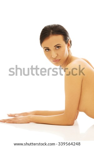 Spa fit woman propping herself on the floor