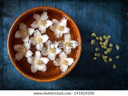 Spa. Flowers in a bowl with water and sea salt - stock photo