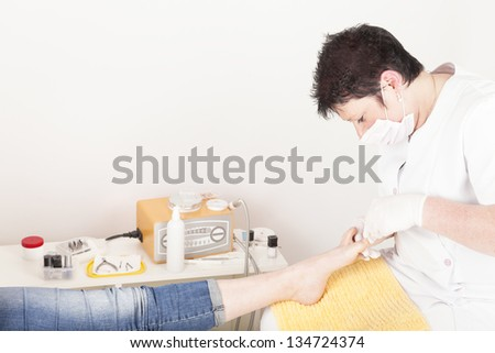 spa foot treatment.  woman foot pedicure in a beauty salon. - stock photo