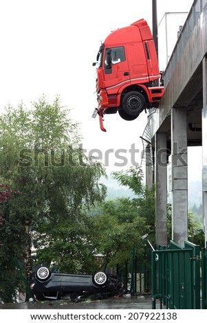 SPA-FRANCORCHAMPS, BELGIUM - JULY 28: Car falls off paddock and truck hangs on the ledge at circuit of Francorchamps on July 28, 2014 in Spa-Francorchamps, Belgium.  - stock photo