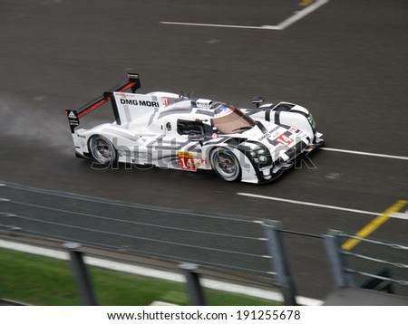 SPA-FRANCORCHAMPS, BELGIUM - MAY 2: No. 14 Porsche 919 Hybrid prototype during round 2 of the FIA World Endurance Championship on May 2, 2014 in Spa-Francorchamps, Belgium. - stock photo