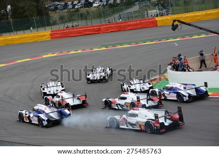 SPA-FRANCORCHAMPS, BELGIUM - MAY 2: The eight leading LMP1 cars in the first corner right after the start of the FIA World Endurance Championship race on May 2, 2015 in Spa-Francorchamps, Belgium.