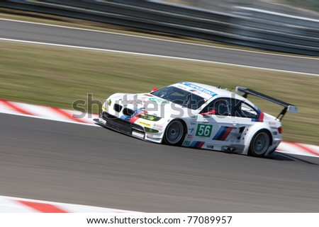 SPA FRANCORCHAMPS - MAY 7: Andy Priaulx, Augusto Farfus, Jorg Muller and Uwe Alzen in the BMW M3 GTR racing on May 7, 2011 in the 1000km race of Spa Francorchamps, Belgium - stock photo