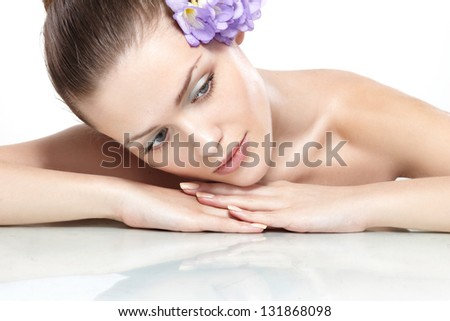 Spa. Fresh clear healthy skin on the face of beautiful woman over white background - stock photo