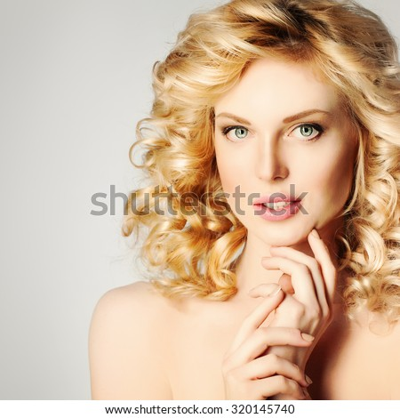 Spa Girl. Beautiful Blonde Woman with Curly Hair - stock photo