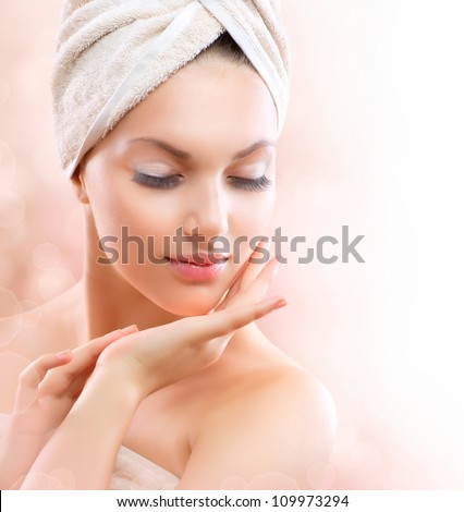 Spa Girl, Beautiful Young Woman After Bath Touching Her Face. Perfect Skin. Skincare. Young Skin - stock photo