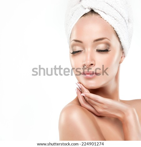 Spa Girl  with clean skin . Beautiful Young Woman After Bath Touching Her Face - stock photo